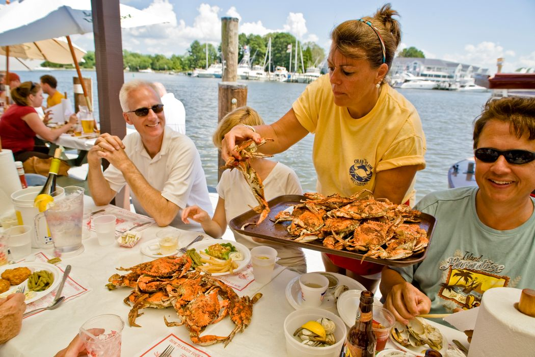 Woman serving steamed crabs