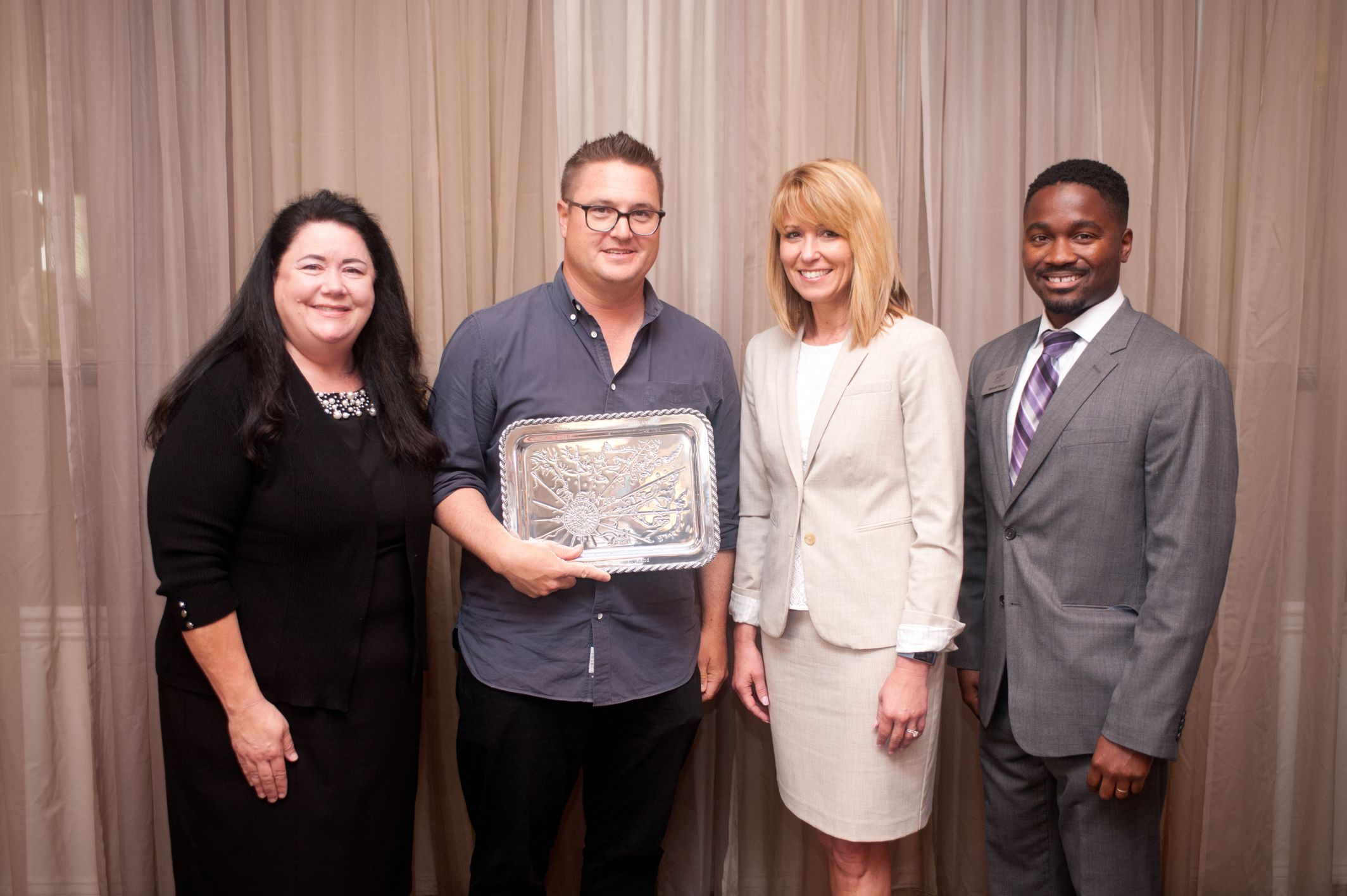 John Flannigan with award